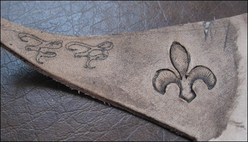 """Fleur-de-lis after coloring. The pattern in the upper-left wasn't actually cut, but was embossed into the leather with my modified """"nail bit"""" on the Cricut."""